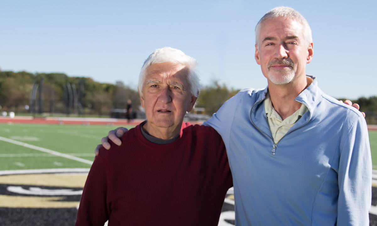 Lakeshore Striders Running Club president Nick Papas and vice president Bob Baril outside at the upper fields at Oakland University