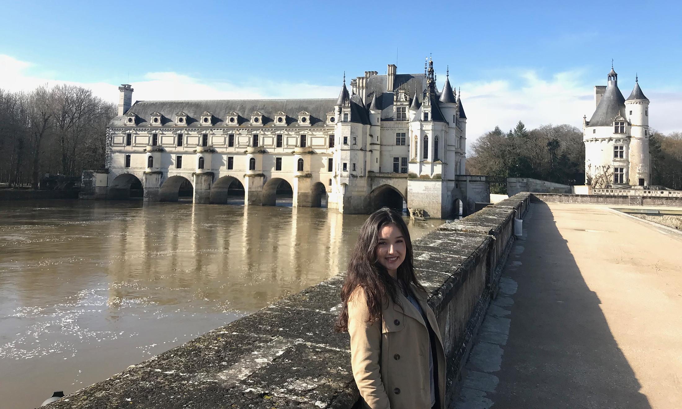 Female student poses at the Château de Chenonceau