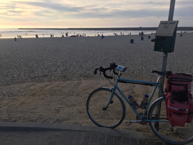 A bike parked in front of a beach