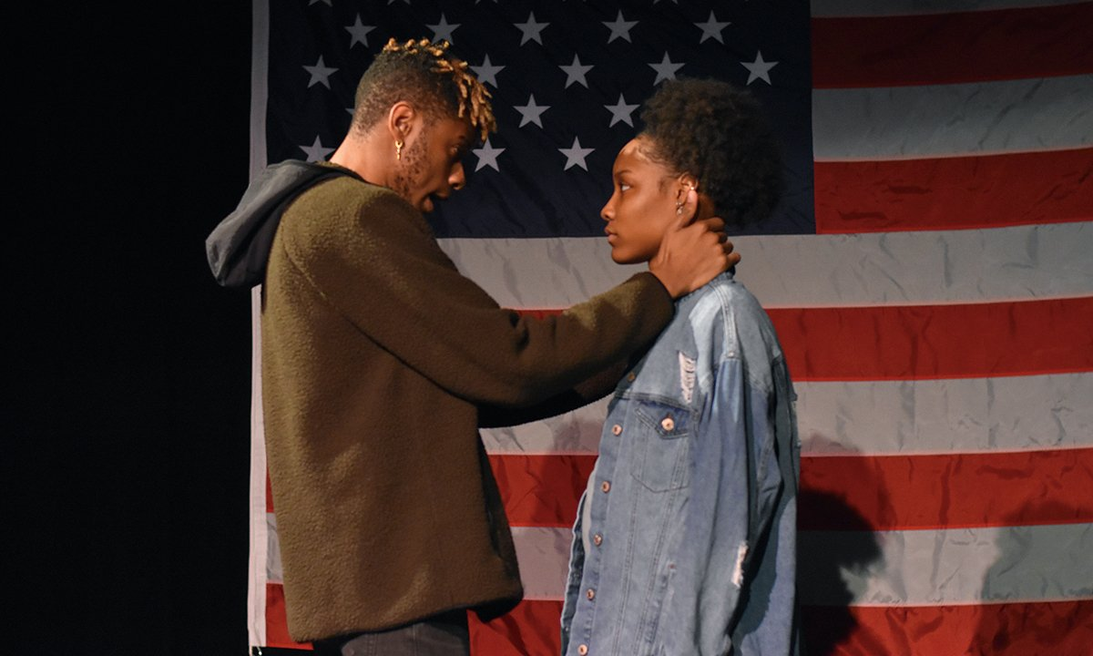 Two people talking on stage.