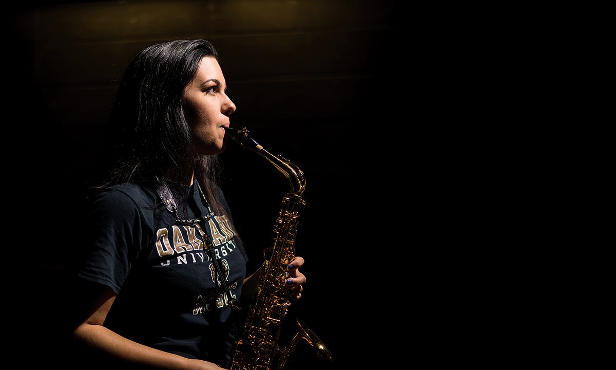 A woman playing a saxophone.