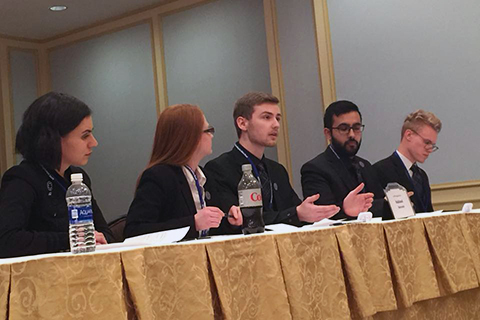 Nick Fontana (center) proposes an argument as team members Genevieve Schmidt, Samantha Sinclair, Hamza Ahmed, and Ian Anderson (left to right) look on.