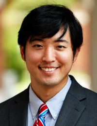 Headshot of John Park in a suit