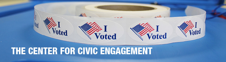 The Center for Civic Engagement roll of stickers with American flags that say I Voted