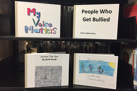 "four books on shelves titled ""my voice matters"", ""people who get bullied"", ""across the sea"" and ""my voice matters!"""