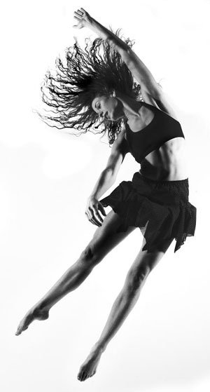 A dancer in a pose in a black and white photo