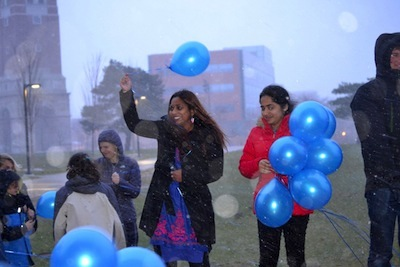 Professor Edrisinha and participants release balloons at World Autism Day event.