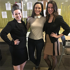 three women in black and gold dresses