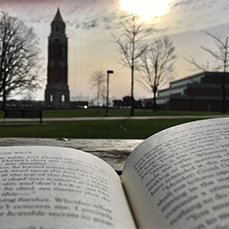 open book with elliott tower in background