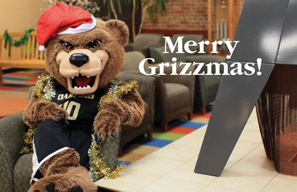 Merry Grizzmas with Grizz in a Santa hat in Fireside Lounge