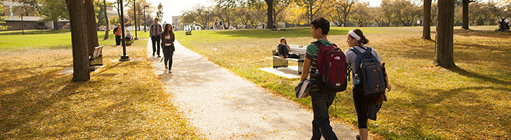 image of two students walking on campus during the fall