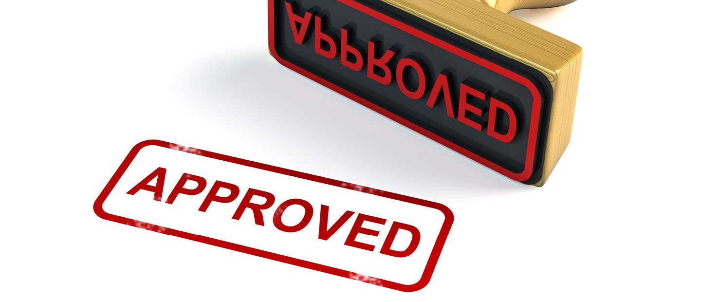 "A stamp in red ink on a white background that says ""Approved"""