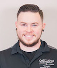headshot of Austin Taylor in a black Oakland University shirt