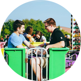 Two men on a green carnival ride